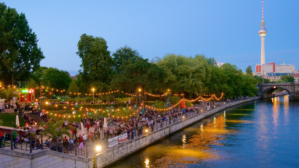 Berlin which includes street scenes and a river or creek as well as a large group of people