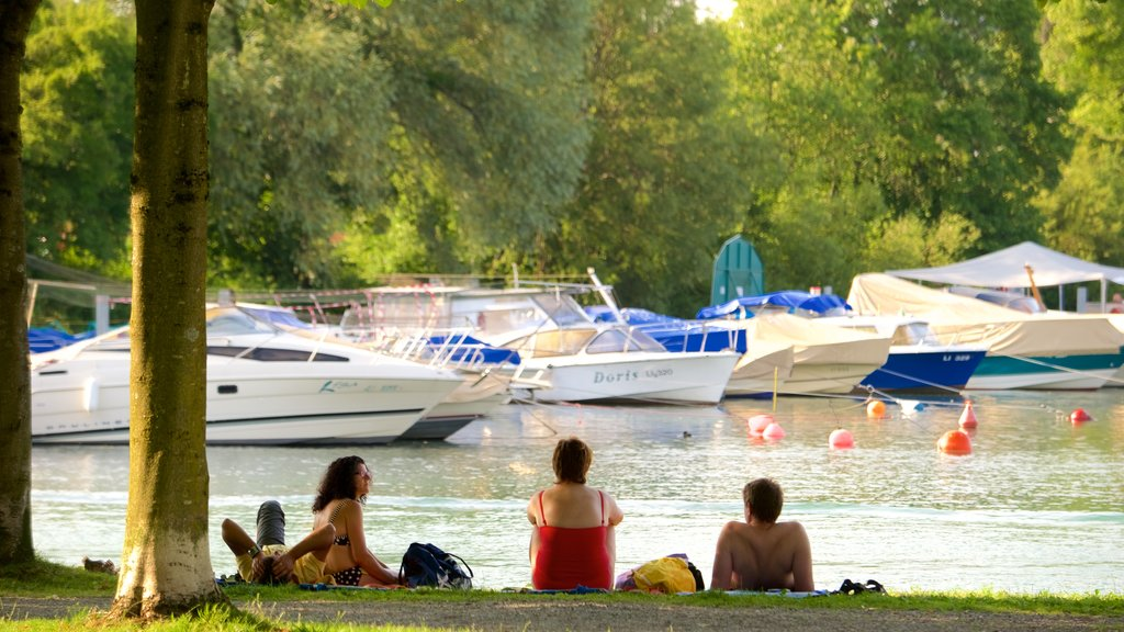 Lindau featuring picnicing and a lake or waterhole as well as a small group of people