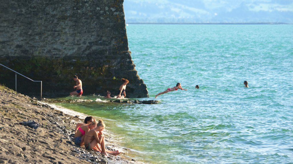 Lindau which includes rocky coastline as well as a small group of people