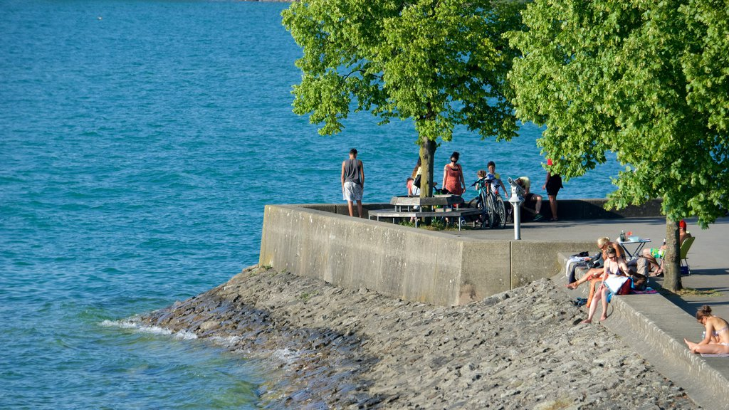 Lindau which includes rugged coastline as well as a small group of people
