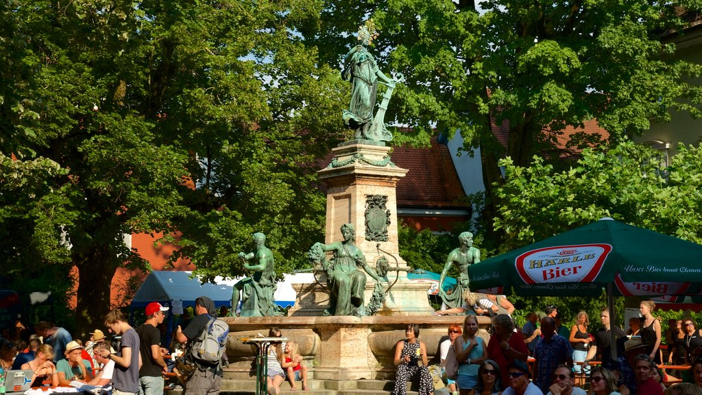 Lindau which includes a statue or sculpture as well as a small group of people