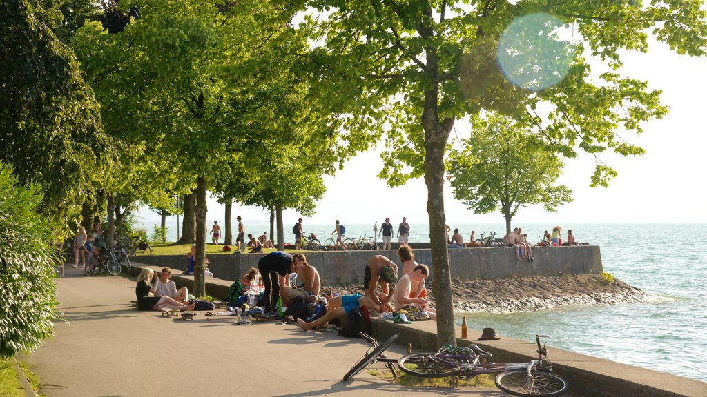 Lindau which includes rocky coastline as well as a large group of people