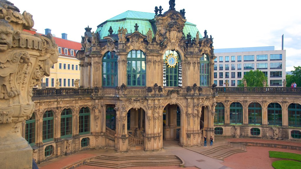 Zwinger Palace showing a castle and a statue or sculpture