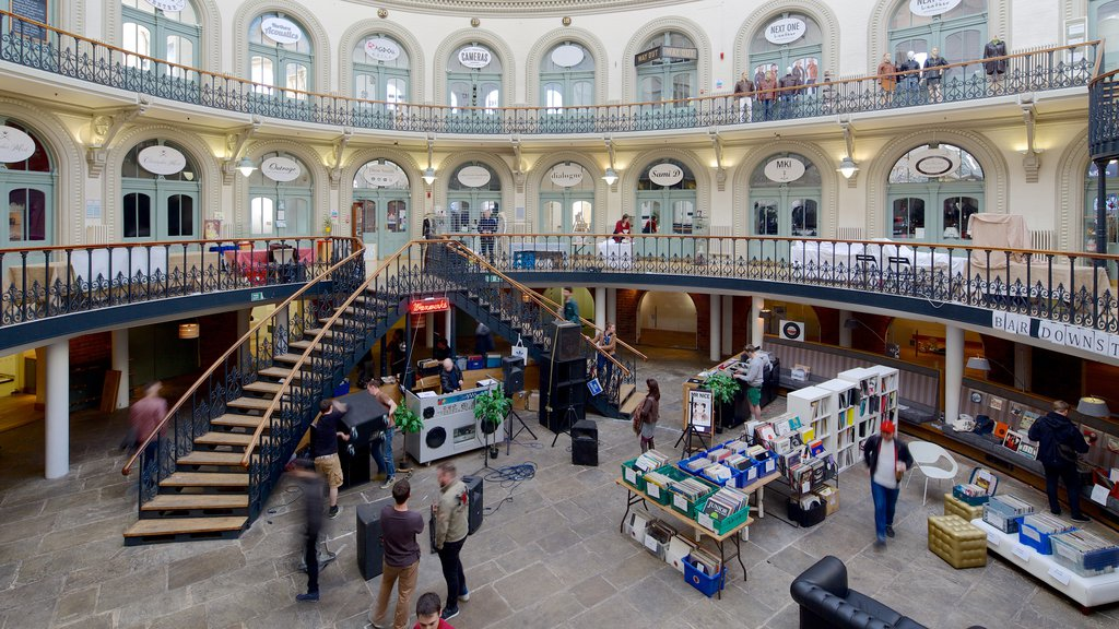 Corn Exchange which includes heritage architecture and interior views as well as a small group of people