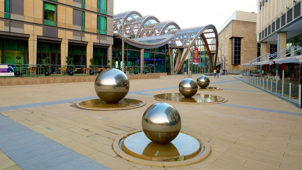 Sheffield Winter Garden which includes modern architecture, a fountain and a square or plaza
