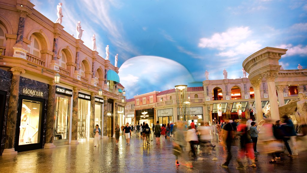 Las Vegas showing interior views and shopping as well as a large group of people