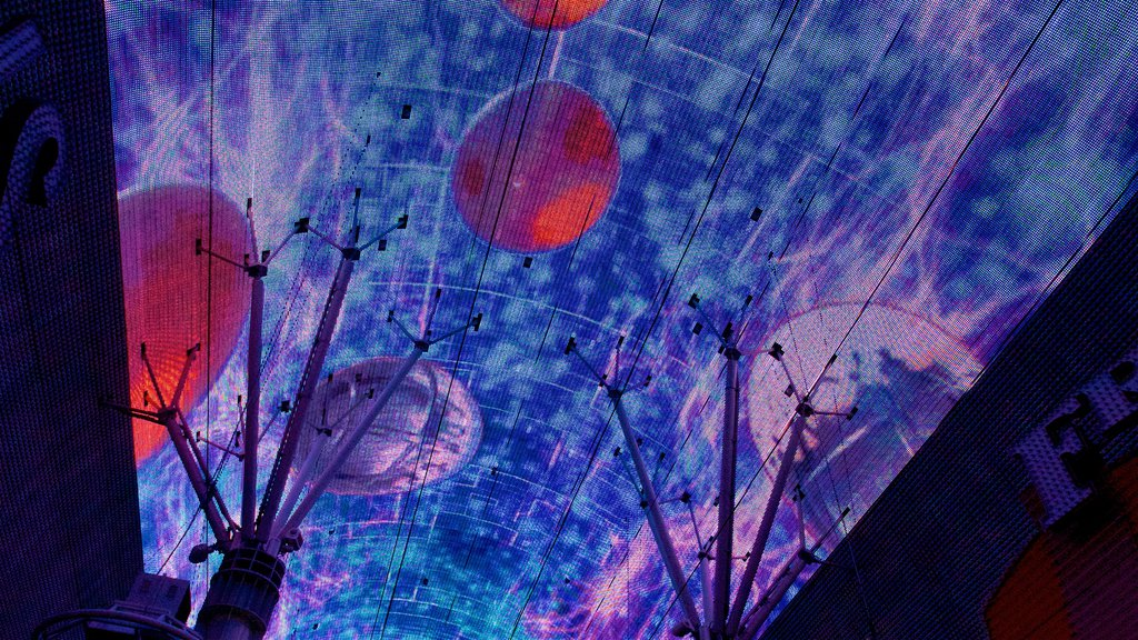 Fremont Street Experience showing outdoor art and night scenes
