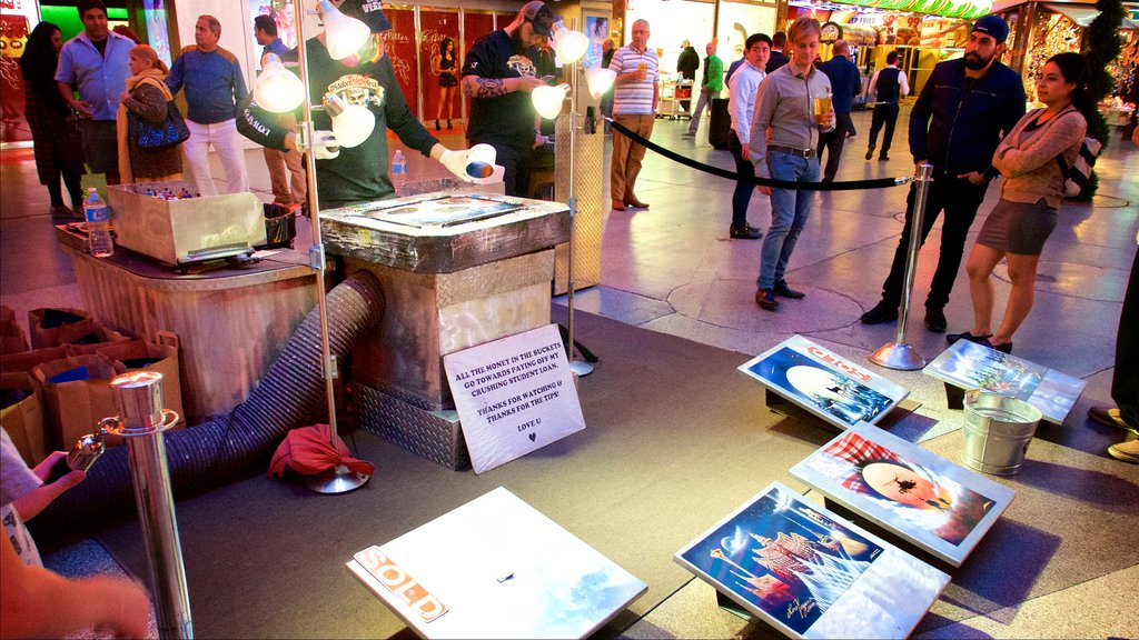 Fremont Street Experience showing outdoor art, night scenes and street performance