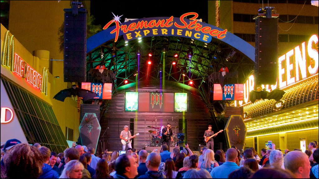 Fremont Street Experience which includes signage, music and night scenes