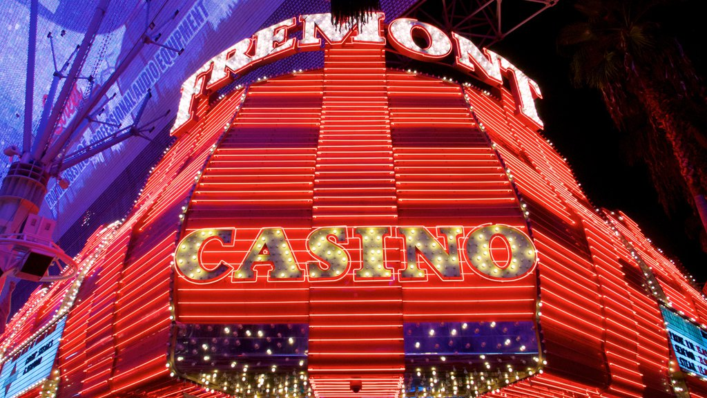 Fremont Street Experience showing a casino, signage and night scenes