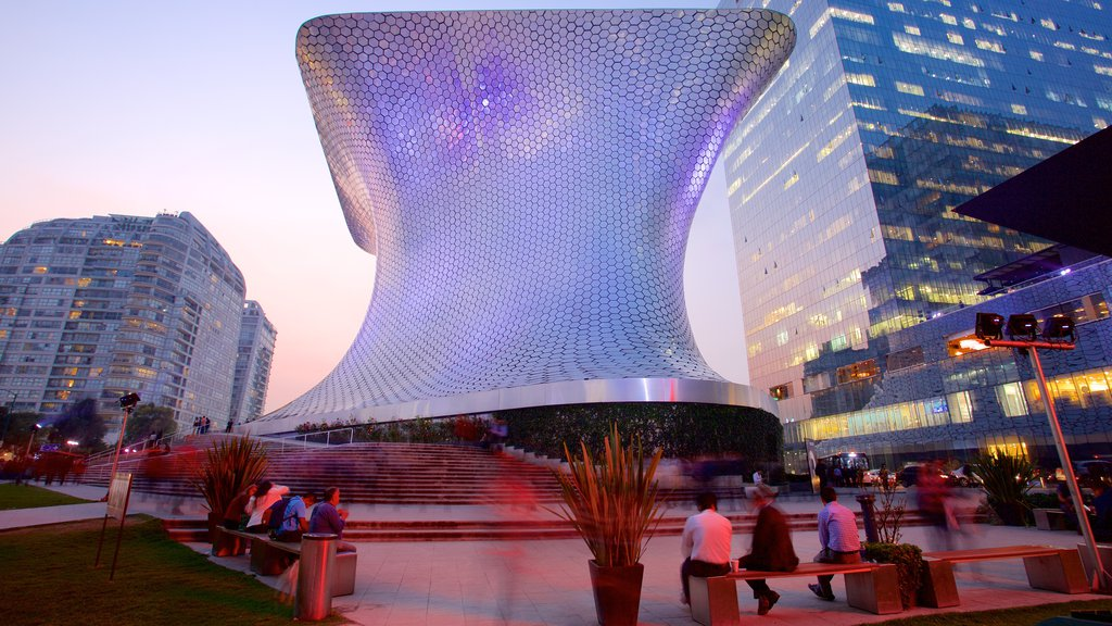 Museo Soumaya showing modern architecture, a city and night scenes