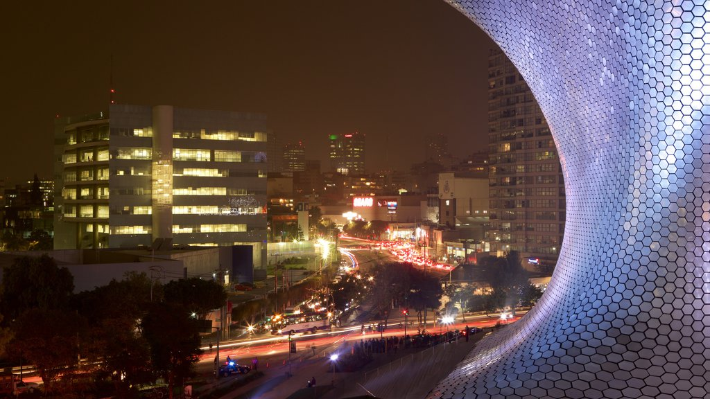 Museo Soumaya which includes modern architecture and night scenes
