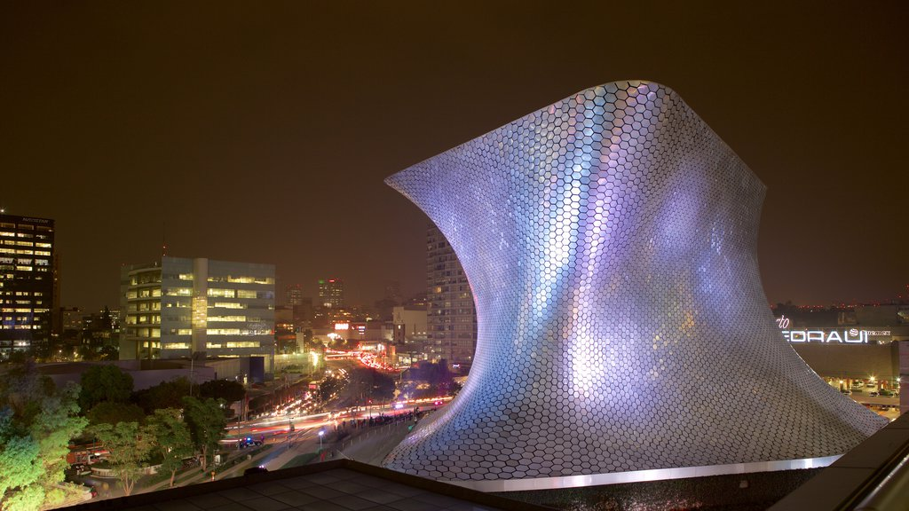 Museo Soumaya which includes a city, night scenes and modern architecture