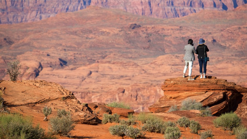 Horseshoe Bend which includes desert views as well as a small group of people