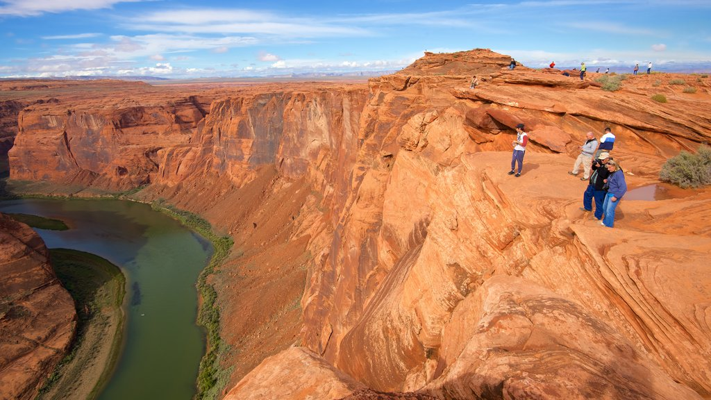 Horseshoe Bend featuring a gorge or canyon, desert views and a river or creek
