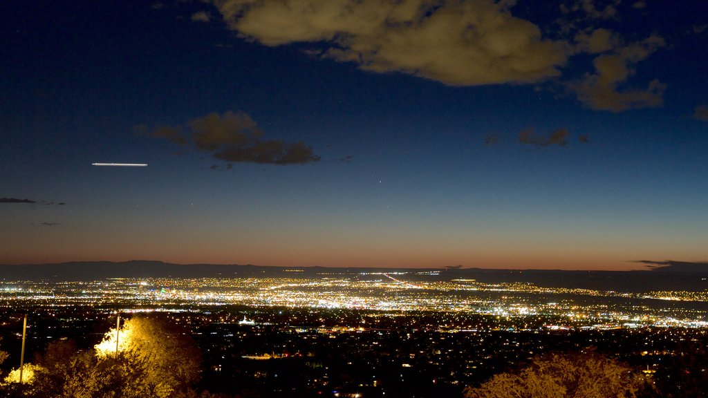 Albuquerque showing a sunset and a city