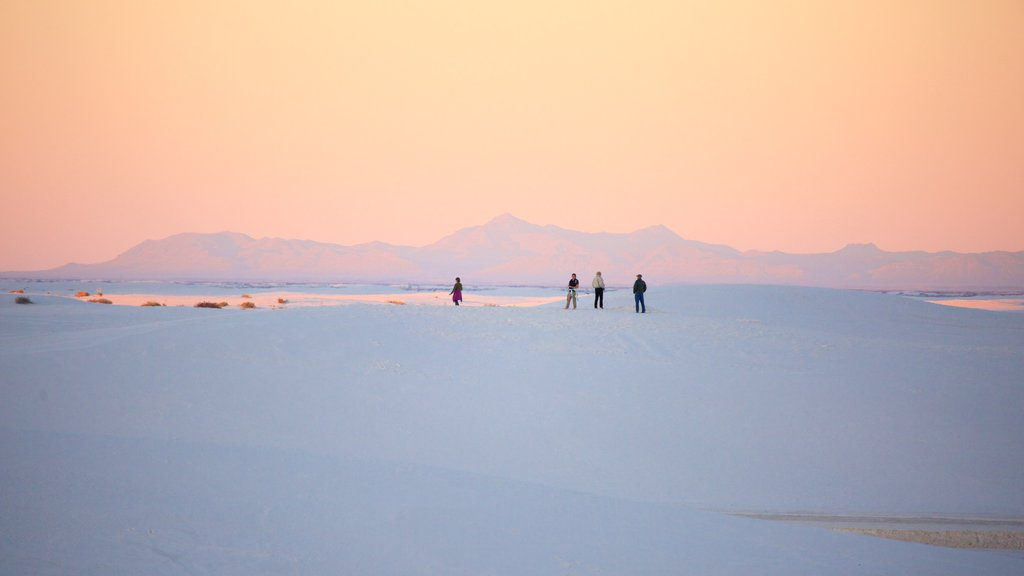 White Sands National Monument which includes a sunset and a sandy beach