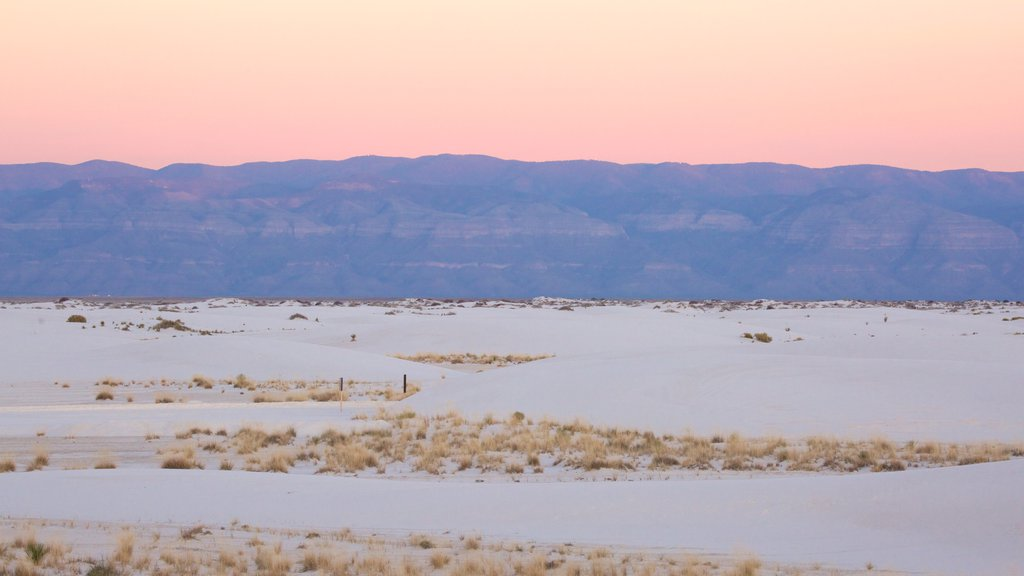 White Sands National Monument showing mountains, a beach and a sunset