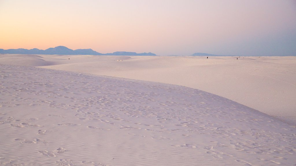 White Sands National Monument showing a sunset, mountains and a sandy beach