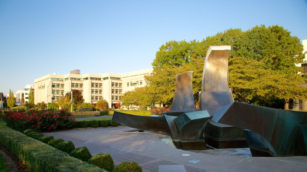 Oregon State Capitol featuring outdoor art and a park