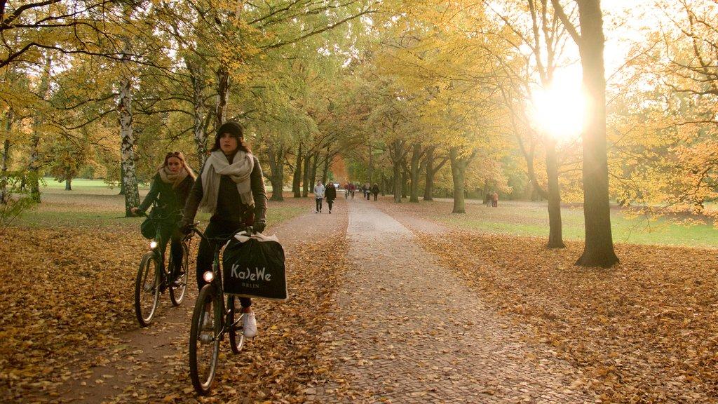 Tiergarten Soviet War Memorial showing cycling, autumn leaves and a garden
