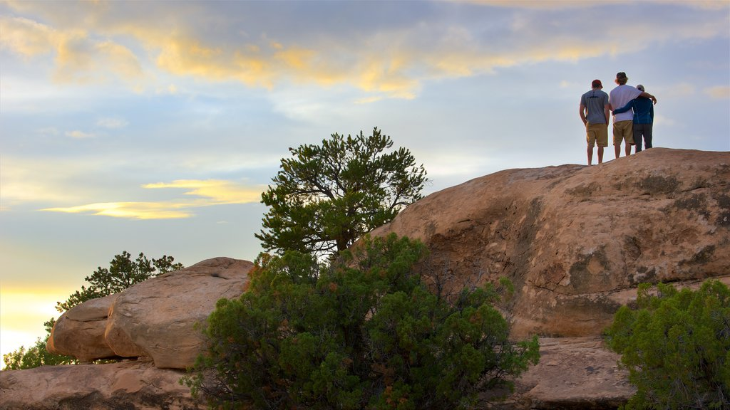 Canyonlands National Park featuring a sunset, desert views and tranquil scenes