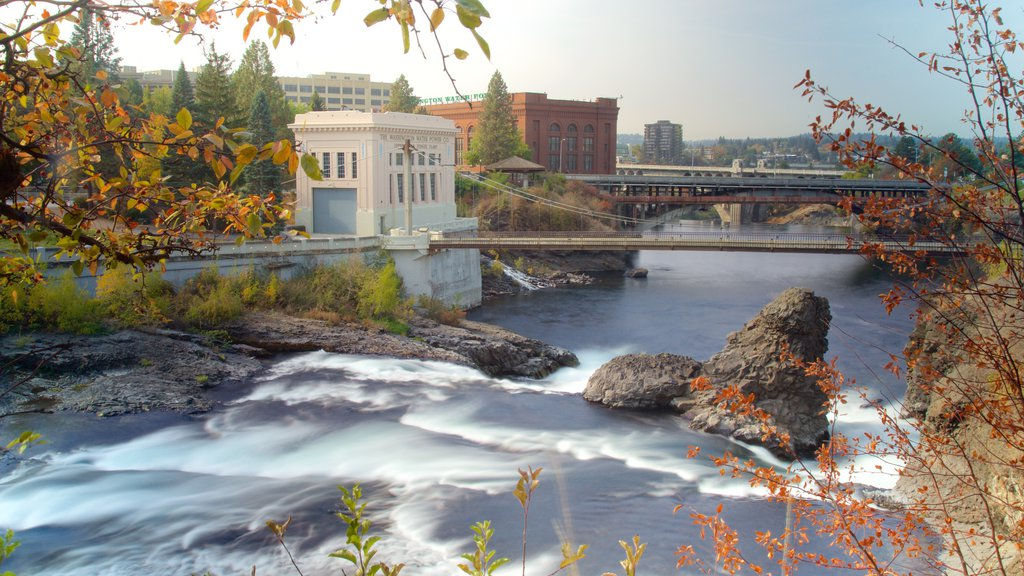 Downtown Spokane featuring a bridge, heritage architecture and a river or creek