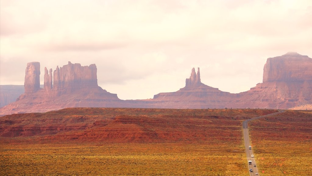 Monument Valley which includes tranquil scenes, a sunset and a gorge or canyon