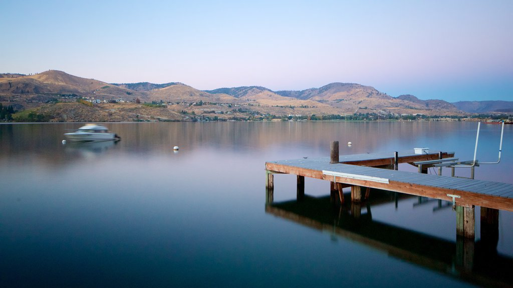 Lake Chelan which includes a lake or waterhole, a sunset and tranquil scenes