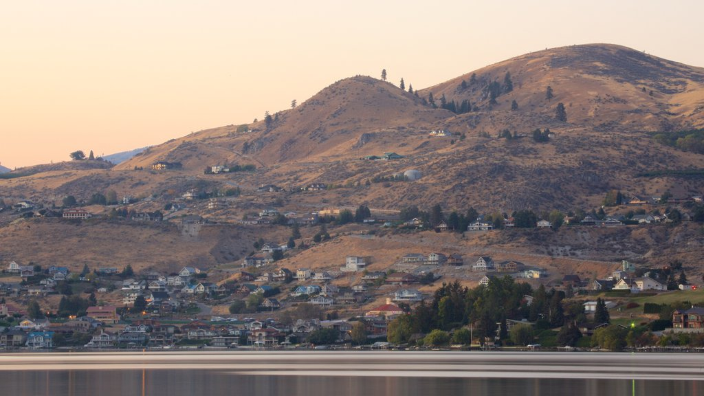 Lake Chelan featuring tranquil scenes, a small town or village and a sunset