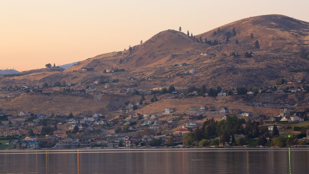 Lake Chelan featuring a coastal town, a sunset and general coastal views