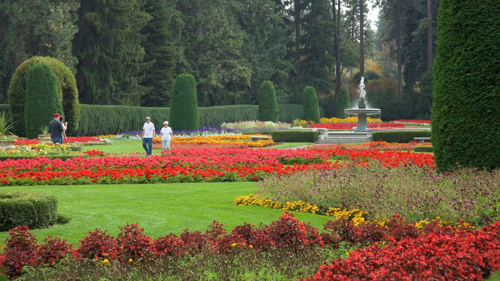 Manito Park which includes a garden and a fountain as well as a small group of people