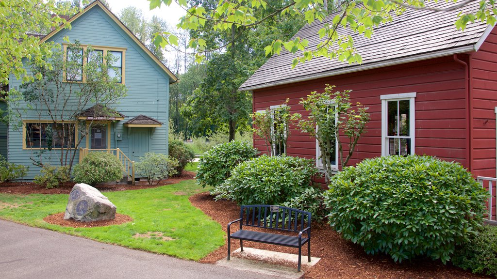 Park at Bothell Landing featuring heritage architecture and a garden