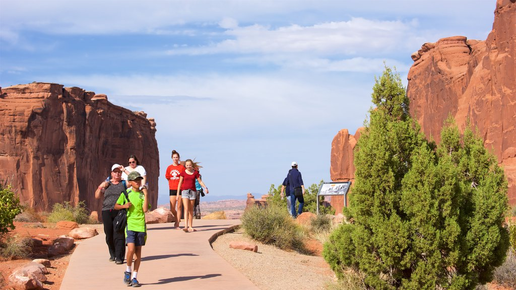 Moab which includes hiking or walking and tranquil scenes as well as a small group of people
