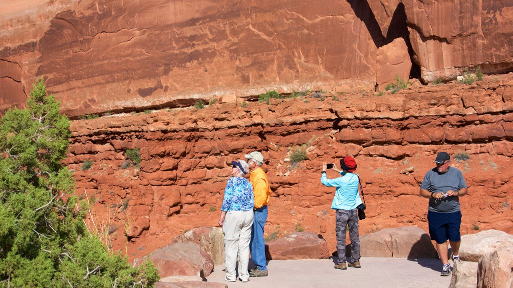 Moab featuring hiking or walking and tranquil scenes as well as a small group of people