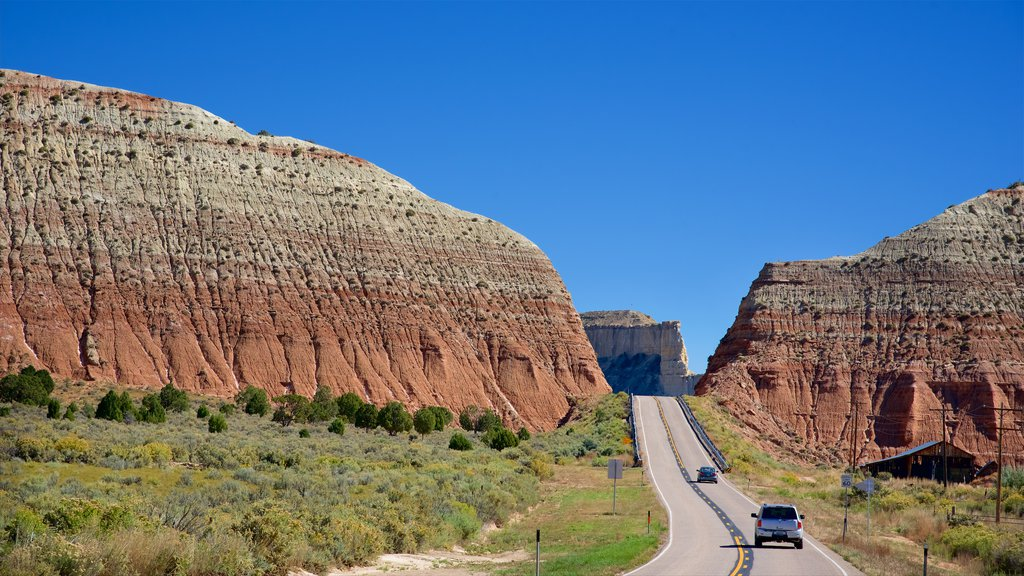 Utah which includes mountains, vehicle touring and tranquil scenes