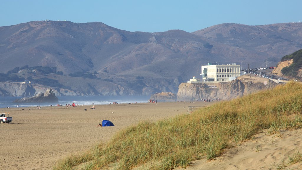 Ocean Beach which includes landscape views, mountains and a beach