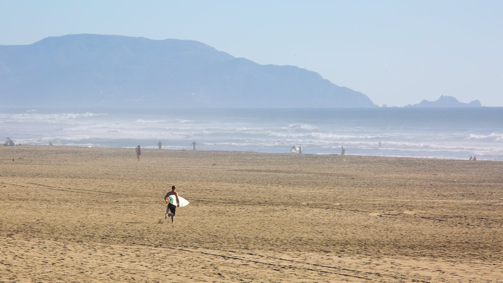 Ocean Beach featuring a sandy beach, landscape views and surfing