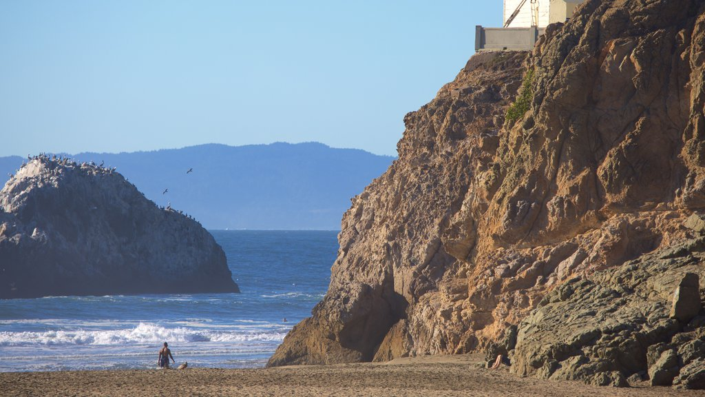 Ocean Beach showing landscape views, a sandy beach and rugged coastline