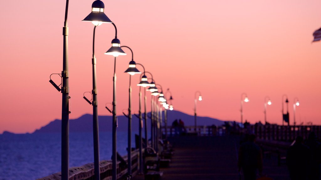 Ventura Pier which includes a sunset and general coastal views