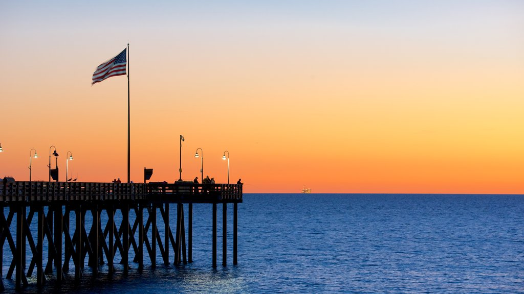 Ventura Pier featuring a sunset and general coastal views