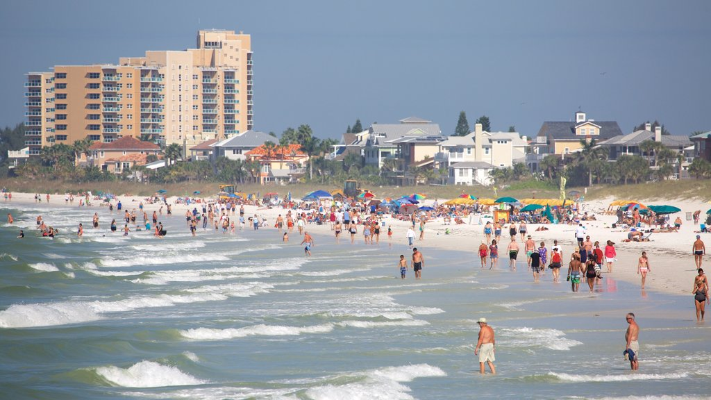 Clearwater featuring general coastal views and a beach as well as a large group of people