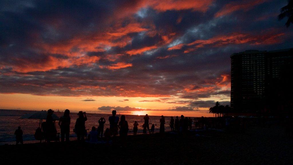Waikiki Beach featuring a beach, a sunset and general coastal views