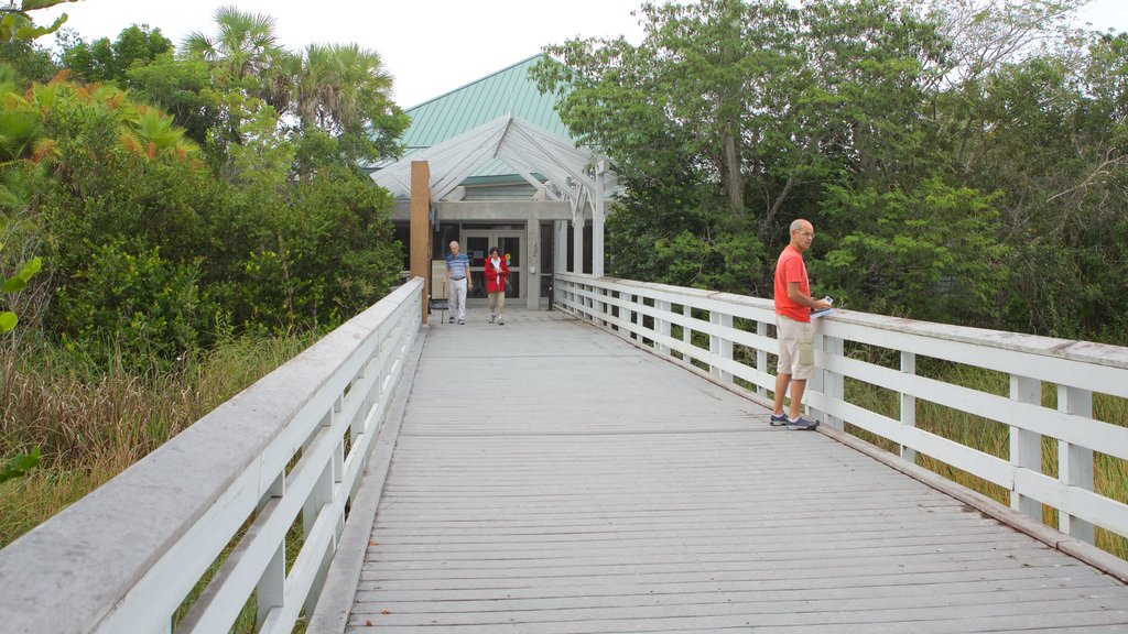 Ernest F. Coe Visitor Center showing a bridge as well as a small group of people