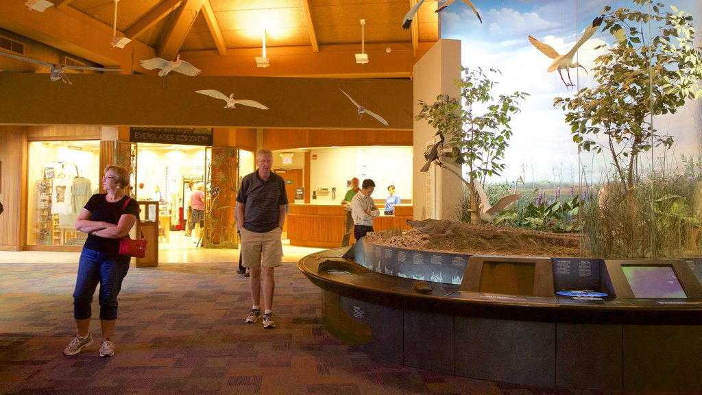 Ernest F. Coe Visitor Center featuring interior views as well as a small group of people