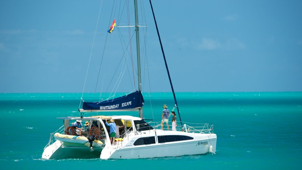 Airlie Beach featuring general coastal views and sailing as well as a small group of people