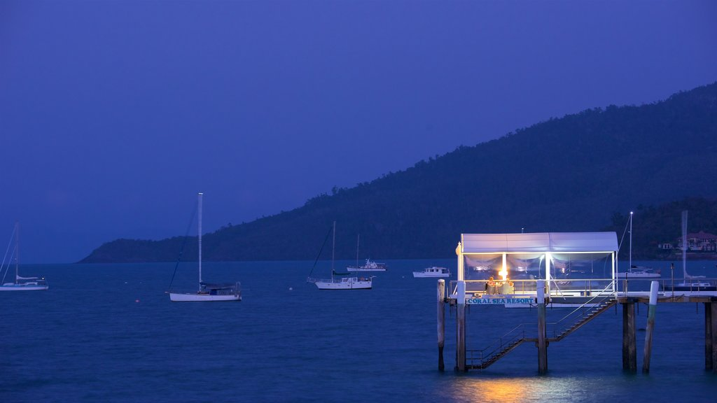 Airlie Beach featuring night scenes, sailing and general coastal views