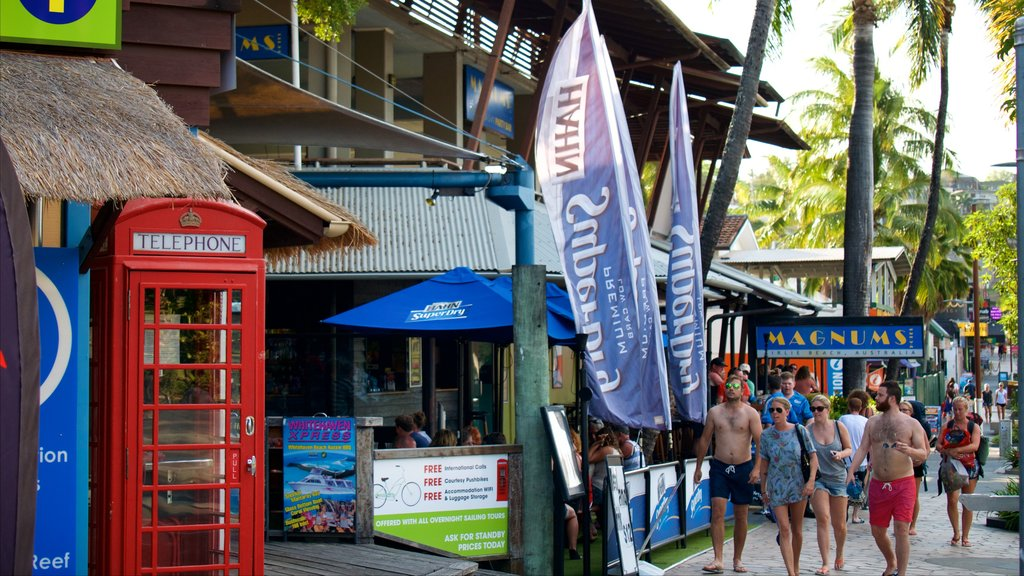 Airlie Beach which includes a coastal town, signage and street scenes