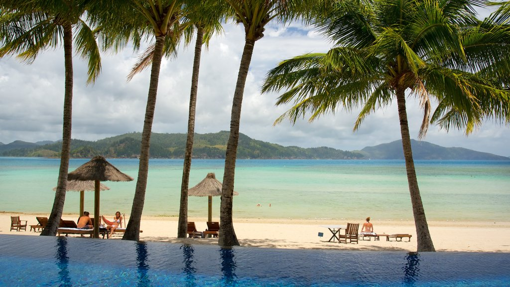Hamilton Island showing a beach, a pool and a luxury hotel or resort