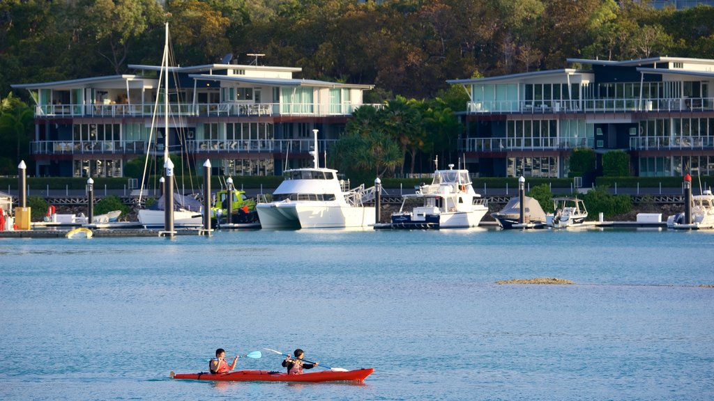 Hamilton Island featuring a coastal town, kayaking or canoeing and a luxury hotel or resort